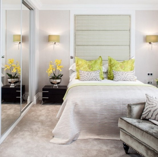 an oversized horizontal headboard over the bed and a glass sliding doors of the wardrobe visually expand the space a lot