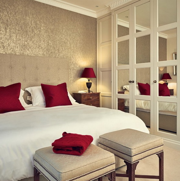 an extended headboard plus mirror doors of the wardrobe make the bedroom look bigger and more welcoming