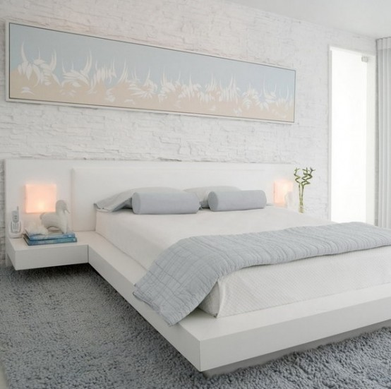 a small bedroom fully done in white and light pastels feels and looks larger and more inviting