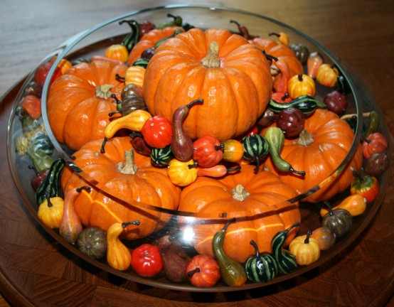 Super tiny faux pumpkins could become a part of a beautiful fall floating arrangement.