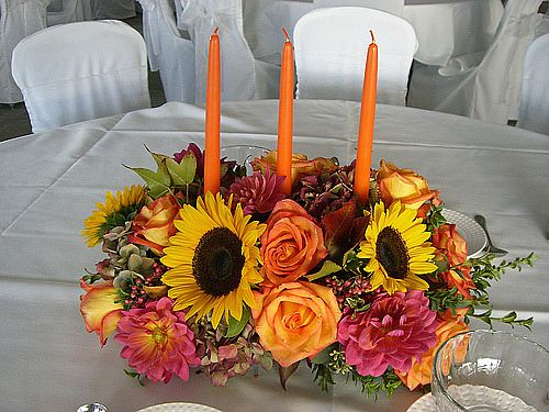 Top off a welcoming Thanksgiving table with a glowing candle centerpiece.