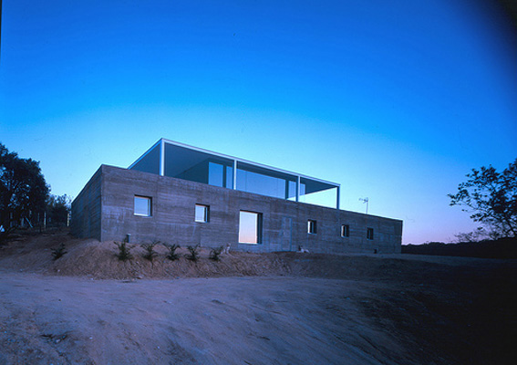 Concrete Box House With Glass Platform On The Top