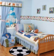 a football-themed blue kid's room with various types of football balls and fun decor is ideal for boys