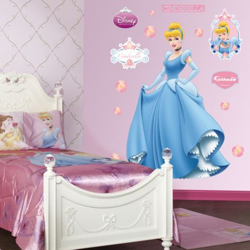 a Disney princess themed kids' room done in pink, with art on the wlal and a bed done with pink bedding