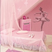 a pink ballerina-inspired kid's room with a canopy bed and a ballet dancer art on the wall
