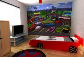 a racing themed kid's room done with a car bed, a car artwork and a colroful tire rug