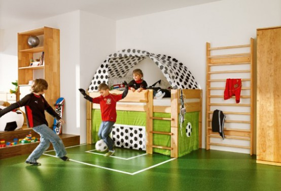 a football-inspired boy's room with a real football space to play here is a dream of all the sporty kids and those who like activities