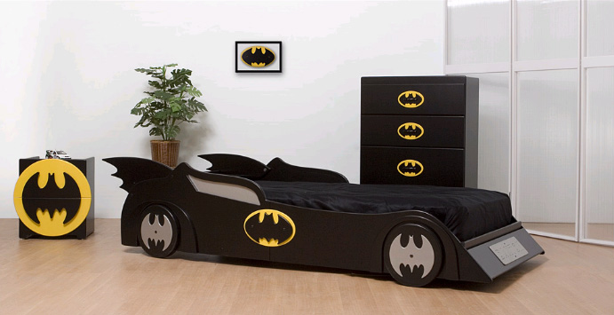 a Batman inspired room with a Batmobile bed, a bat dresser and a bat cabinet is a very edgy and bold idea