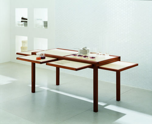 Cool expandable coffee and dining tables by sculrtures for Expandable dining table for small spaces