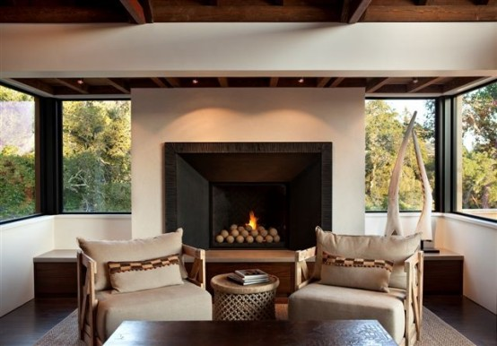 Modern-armchairs-and-table-with-fireplace