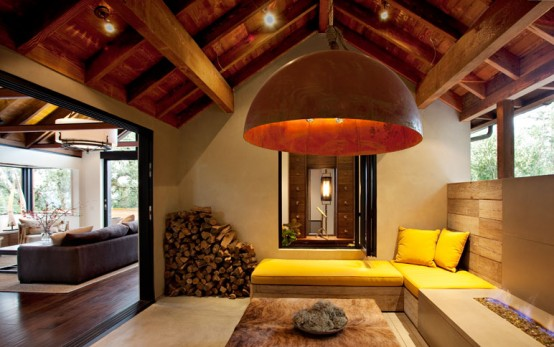 Modern-interior-design-with-yellow-bed-sofa-and-with-wooden-table