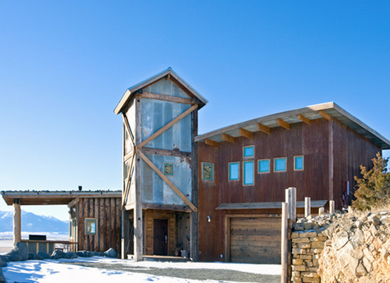 Home With Weathered Wood And Metal Exterior