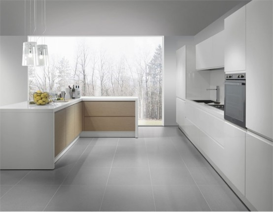 25 modern kitchens in wooden finish digsdigs for Casa moderna total white