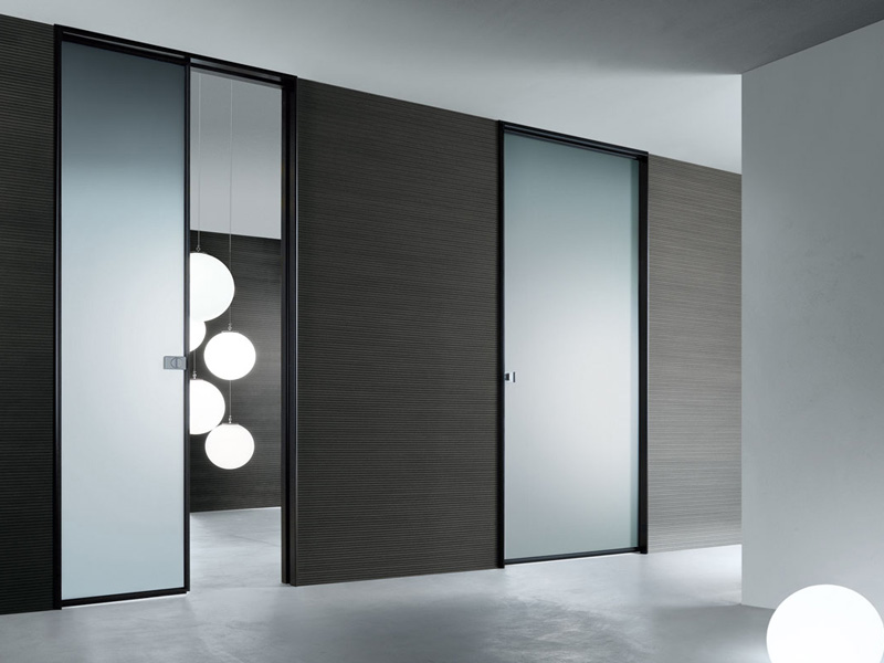 Modern interior glass doors spin by rimadesio digsdigs for Contemporary interior doors