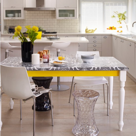 Monochrome Kitchen Diner With Yellow Accents