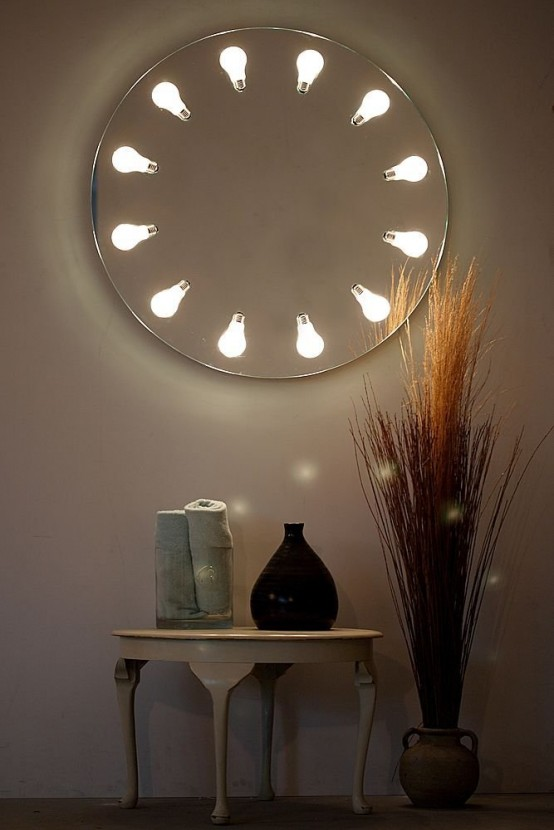 Round wall mirror with original lighting perito moreno for Miroirs decoratif
