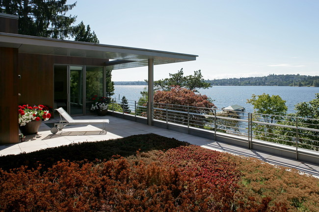 Waterfront House With Numerous Exterior Courtyards And Terraces
