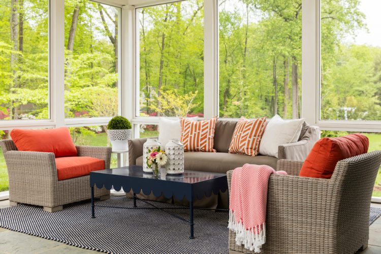 A Classic Choice Of Seating Furniture For A Sunroom With Colorful Pillows