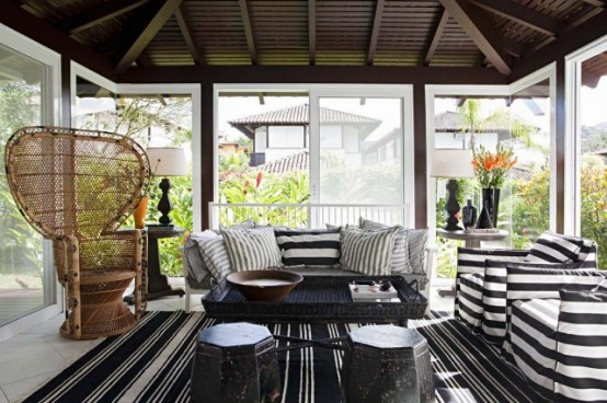 A sunroom for gatherings with lots of black and white stripes.