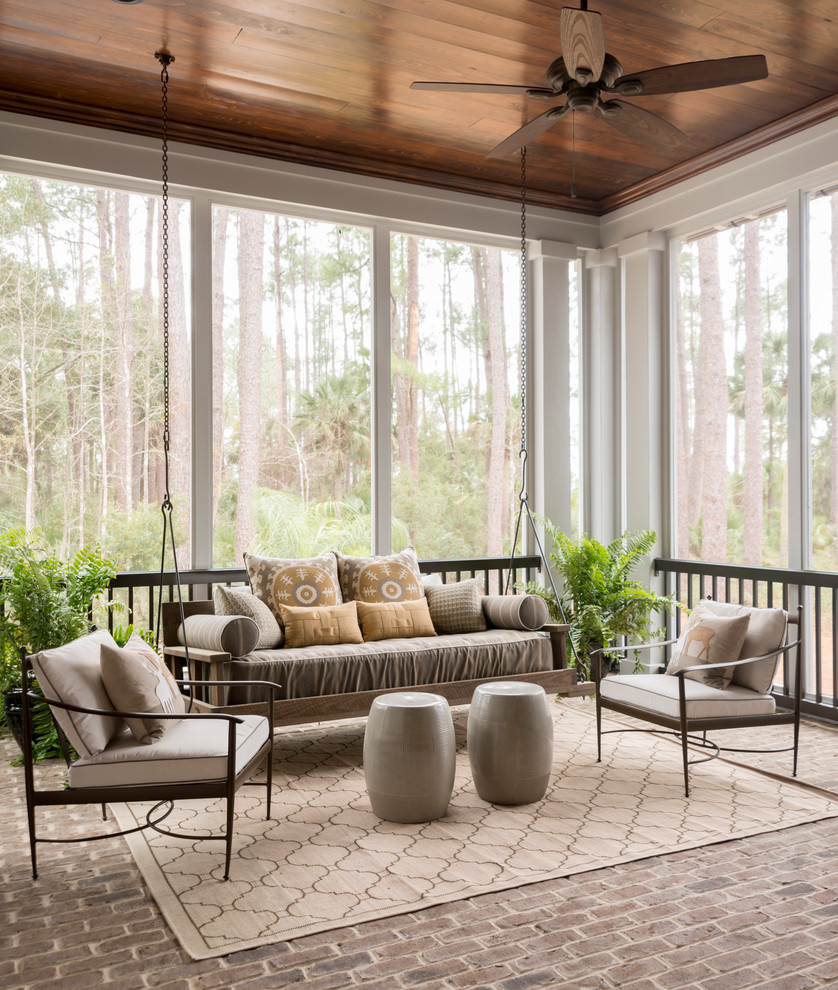 a handing daybed is a perfect furniture choice for a sunroom