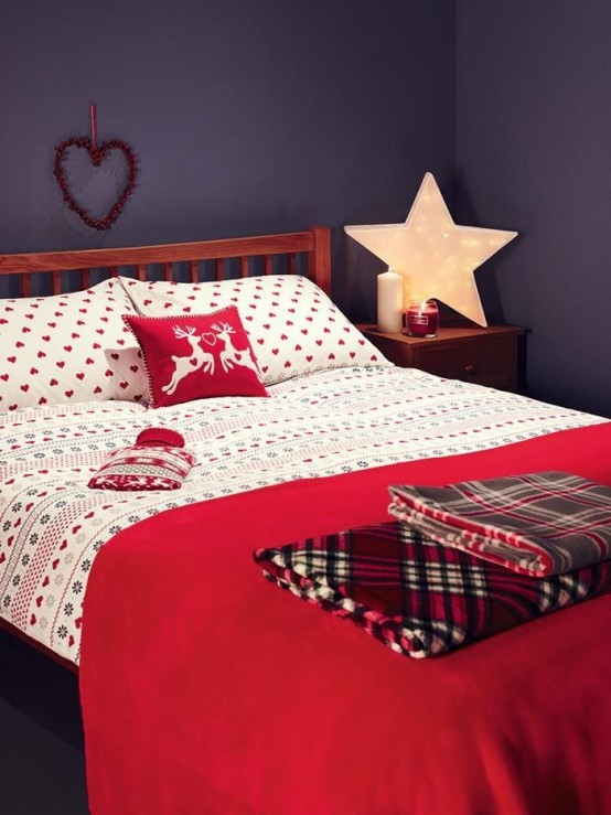 red and white bedding, plaid blankets and a marquee star as a lamp for a Christmas bedroom