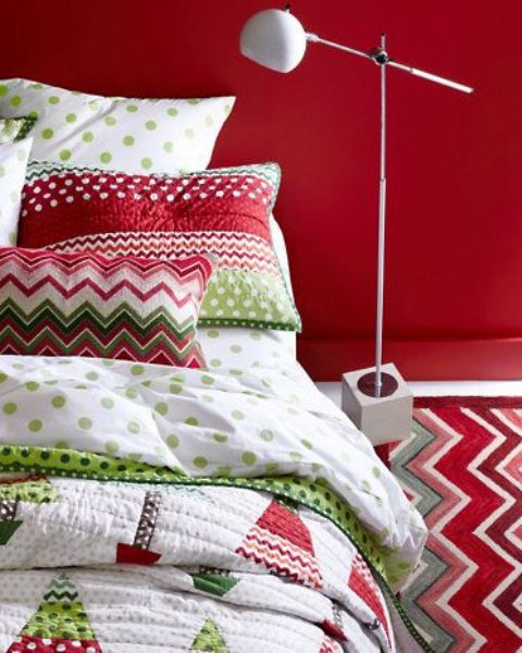 a red statement wall and red, green and white bedding for Christmas will make you feel fun and cheery
