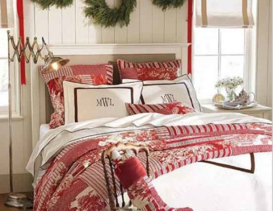 a red and white bedding set, evergreen wreaths over the bed will make your bedroom feel likeChristmas