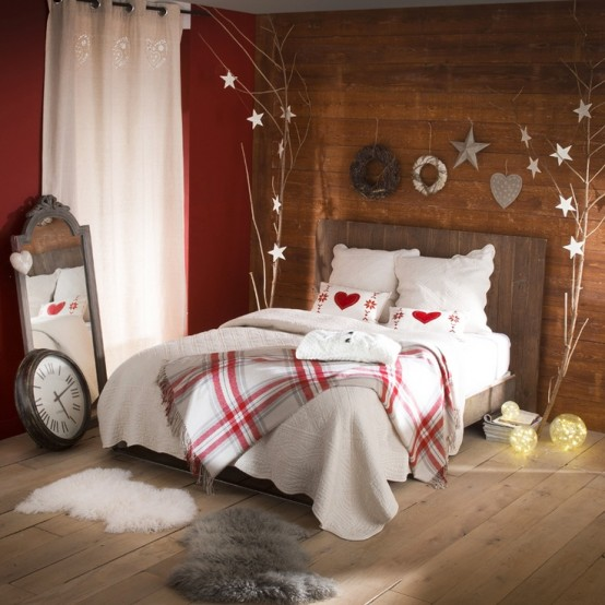 plaid bedding, Christmas trees with heart and star ornaments hanging for a cute winter-like look