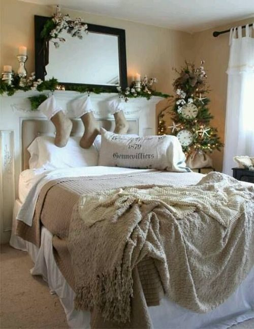 a neutral Christmas bedroom with evergreens, white blooms and cotton, candles and vintage-inspired bedding with ruffles and a crochet blanket