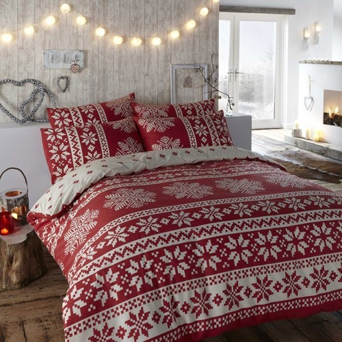 string lights, red lanterns and red and white printed Christmas bedding for a holiday-like space