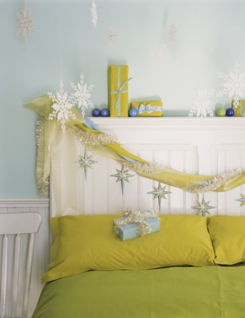 bold neon green and yellow bedroom with snowflakes, blue ornaments and brign bedding for a non-traditional look