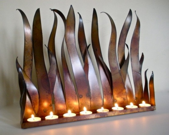 a metal holder inspired by grass or flashes of fire is a unique solution for your home