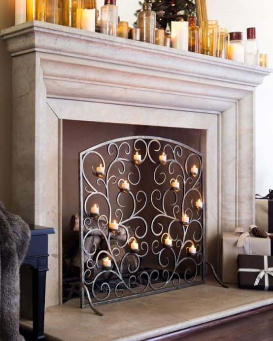 a gorgeous ornate metal screen with small candles is a chic and refined touch to your fireplace that will look like no other