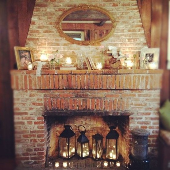 candle lanterns and tealights in the fireplace and candles in mercury glass candle holders