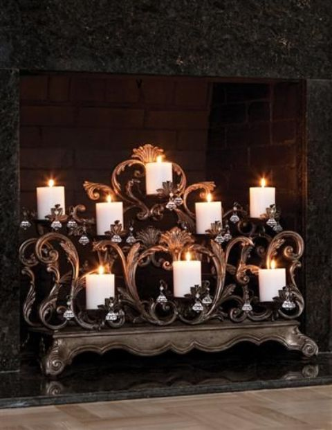 an exquisite candelabra with vignettes and hanging crystals for chic fireplace decor