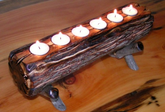 a wooden log with tealights in it and on a stand can be an easy DIY for your fireplace