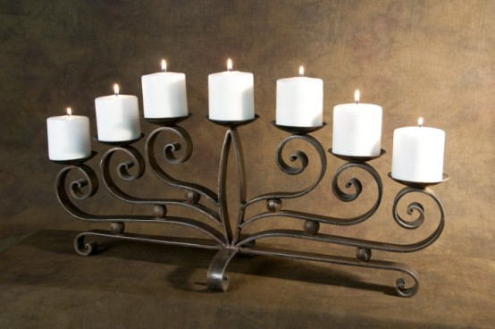 a refined metal candelabra with candles is all you need for a cozy fireplace