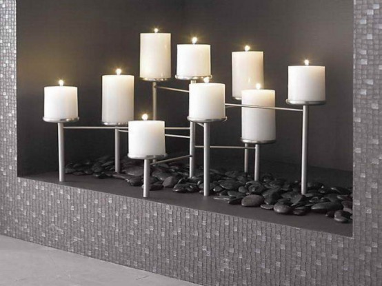 modern styling with black pebbles and a laconic metal candelabra for a minimalist space