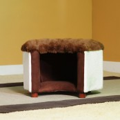 an ottoman and pet bed in one covered with faux fur is a very cozy piece for your pets