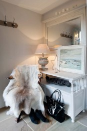 a chair with a faux animal skin is a lovely piece to rock during cold days, it will fit any space
