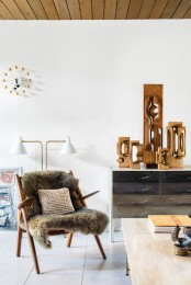 a mid-century modern chair with a grey faux fur cover is a great furniture piece for cold seasons