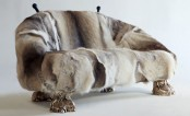 a quirky sofa covered with fur and with gold legs imitating animal ones is a crazy piece that will make a statement