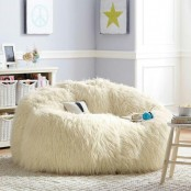 a large white faux fur beanbag chair is amazing to sit and lit on it and you will get relaxed very easily and fast