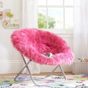 a cool hot pink faux fur chair is a lovely bright and glam piece to rock, it will add color and coziness to the space