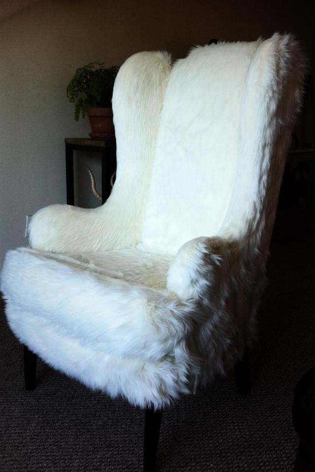 a vintage chair covered with white faux fur is a lovely idea for accenting your space and make it comfortable