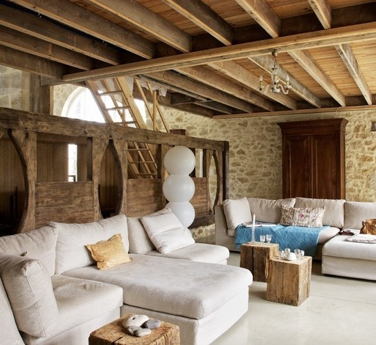 a combo of stone walls and a wooden beam ceiling is a gorgeous rustic idea to go for