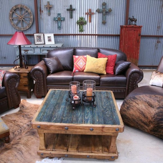 a rustic meets industrial living room with leather and wood furniture, with reclaimed wood and corrugated metal