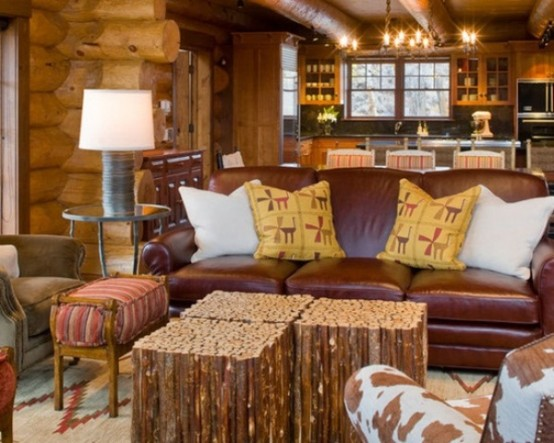 wooden walls, stick coffee tables and leather furniture make the space rustic and cool