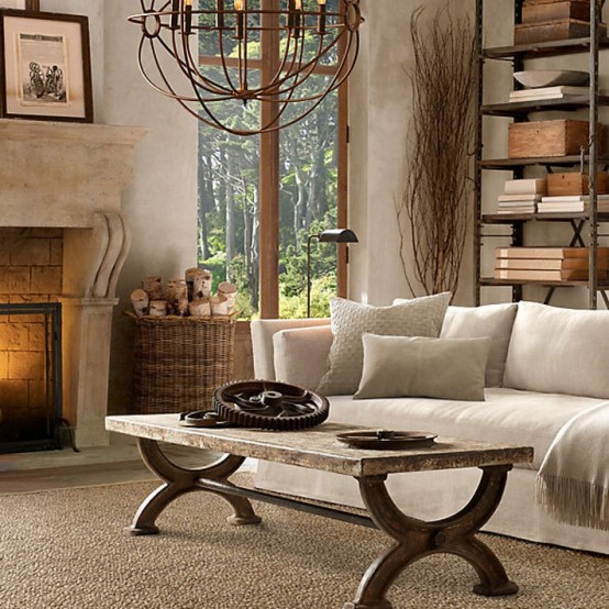 a large fireplace, rustic wooden furnniture and an orb chandelier plus firewood in a basket