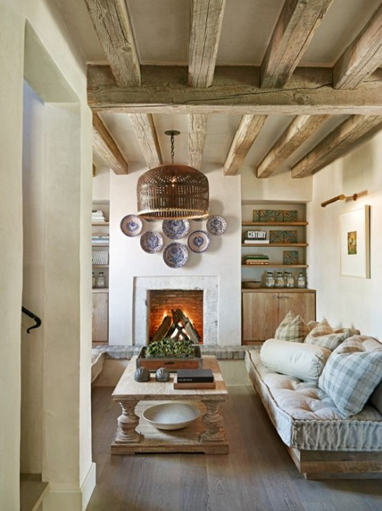 wooden beams, a fireplace and wooden rustic furniture plus built-in furniture